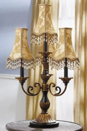 Cbk styles 54960 table lamp with 3 scroll arms black and copper cbk styles 54960 table lamp with 3 scroll arms black and copper finish four light candelabra style round scalloped bell shades inline switch aloadofball Choice Image
