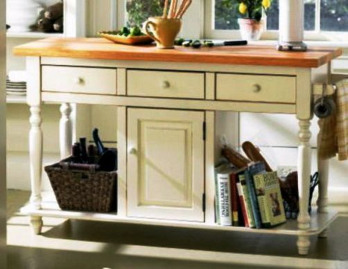 homecraft hcmi159wh kitchen island cabinet model beaumont isle white expansive hardwood top rests on turned legs and makes prep work a pleasure
